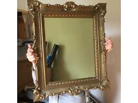 Mirror with antique style decorative moulded frame