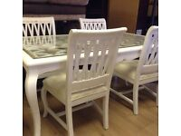 White painted table with 6 chairs