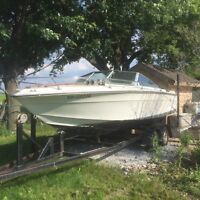 24 ft boat & trailer as is.  Trailer in good condition