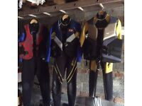 3 wetsuits with 3 life jackets good condition