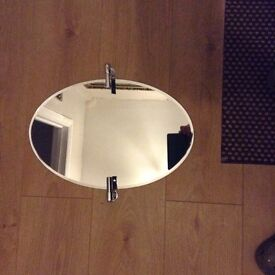 Small oval tilting mirror unused