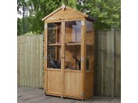 Wooden Cabinet Greenhouse ideal for small gardens.