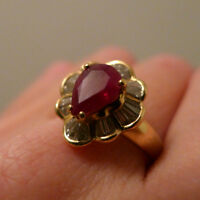 Ladies 18Kt. Yellow gold Ruby & Baguette Diamond surround ring.
