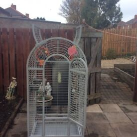 There's is four large parrot cages