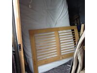 Small double bed size approx 47 inches wide with thick mattress wooden sides