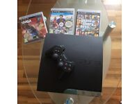 PlayStation 3 console with 5 games