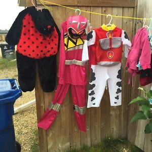 Lady bug fits 4t.  Power ranger fits 7/8   Marshal is gone