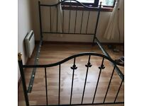 Wrought iron double bed. Excellent condition.