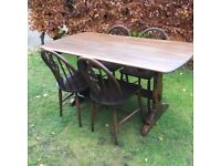 Ercol dining table and 4 chairs with original Ercol cushions
