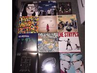 Vinyls and player for sale