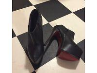 Red sole black platform boots