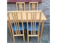 Light dining table and 4 chairs