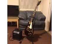 Vintage V100 guitar w/ stand and amp