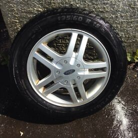 Set of four, four stud Ford Alloy wheels n good tyres.