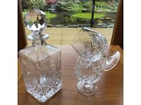Brandy decanter and two crystal glasses
