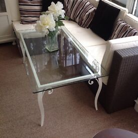Versatile glass topped metal coffee table.