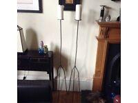 2 metal floor standing candle sticks