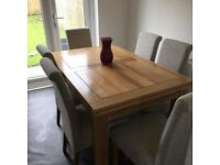 Oak dining table for sale, with 6 chairs. Extends to fit 8 people.