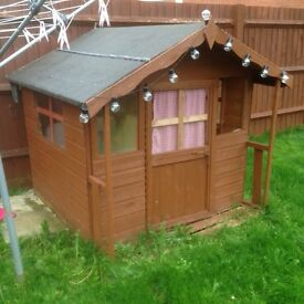 Wooden play house (reduced for quick sale).