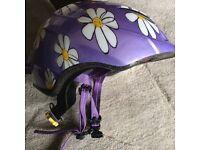 Specialised purple helmet with daisies. Bike, scooter, skateboard