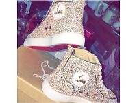 Gold louboutin trainers
