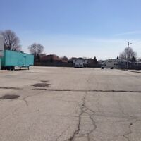 1.5 Acres Of Paved Parking Space Available!