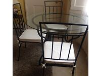 Wrought iron & Glass table with 4 chairs