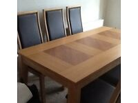 Solid Oak Dinning Table and Six Chairs