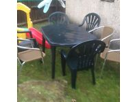 Garden table and 7 chairs for sale £30 cont details 07869702038