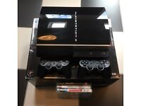 PS3 40GB console with two controllers, remote and three games.
