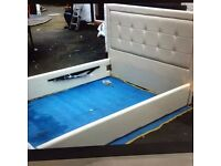 White leather double and king sized beds