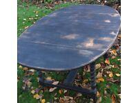 Oval drop leaf barley twist dining table painted in Miss Mustard Seed Milk Paint Typewriter black