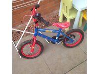 Wee boys Spider-Man first bike