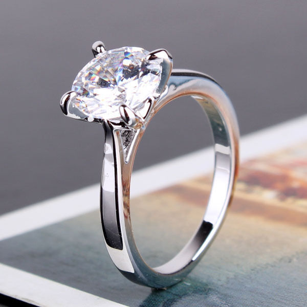 Diamond Solitaire Ring With Sapphires
