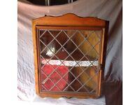 Corner display cupboard with leaded glass door