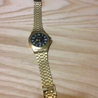 Gold watch with glow in the dark numbers