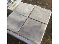 9.7m2 of grey riven effect paving 450x450mm