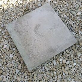 Three square paving stones