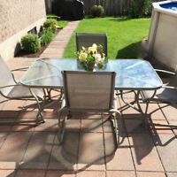 Patio table with glass top and 4 chairs