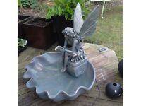Fairy on a clam water feature with pump