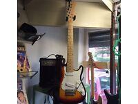 3/4 Strat type guitar + amp + lead + strap + picks