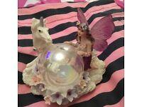 Fairy and unicorn with glass globe