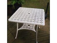 Four seater cast aluminium table (damaged)