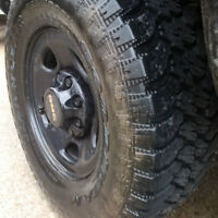 8 bolt GMC rims and Goodyear Territory LT265/75/16 Tires