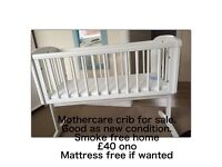 Mother are swinging crib