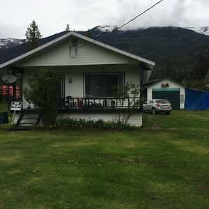 Cottage near lakes and mountain trails in Trout Lake, BC I Revelstoke British Columbia image 1