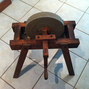 Antique sharpening stone wheel