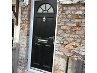 Black composite front door with glass section