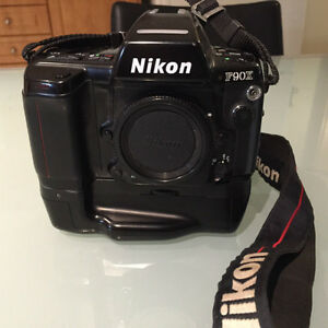 Nikon F90X film body with MD10 motor drive and SB25 flash unit‏