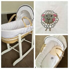 Nearly new Moses Basket with rocking stand and fitted sheet